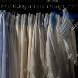 hangers-with-different-clothes-in-the-closet-wardrobe-full-of-clothes-RJM6Y4